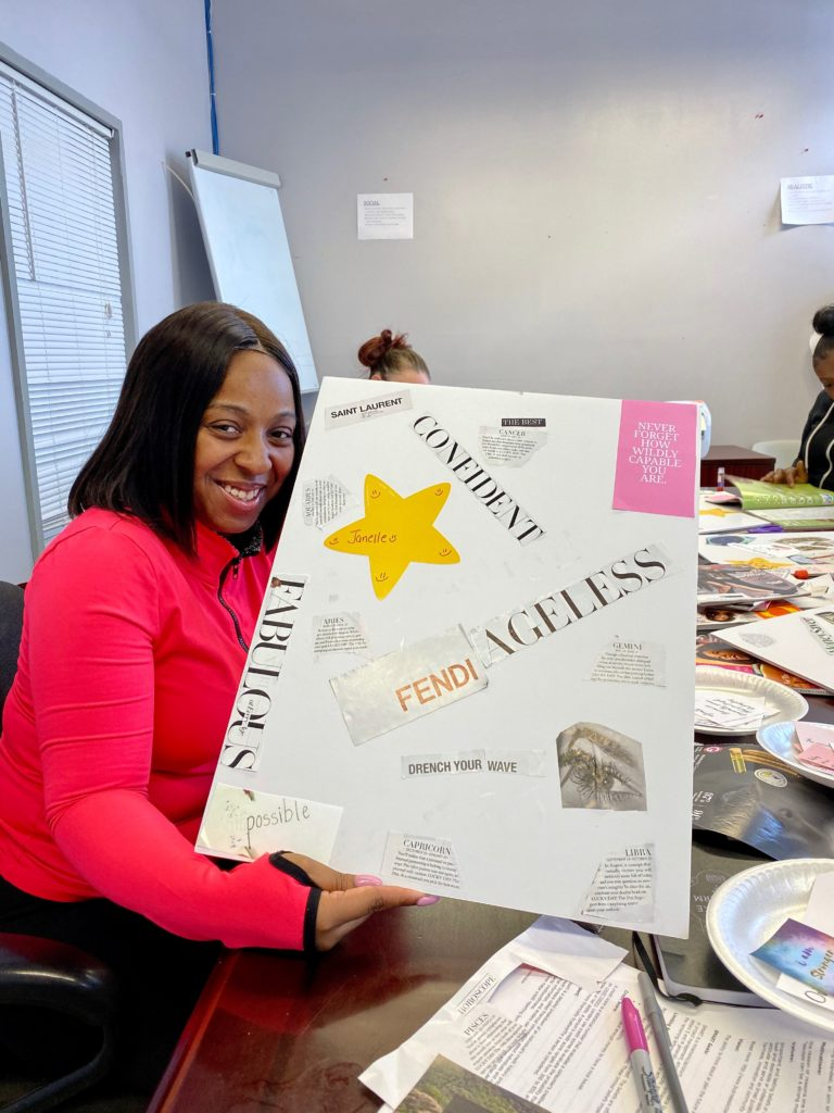 Client showing off Vision Board